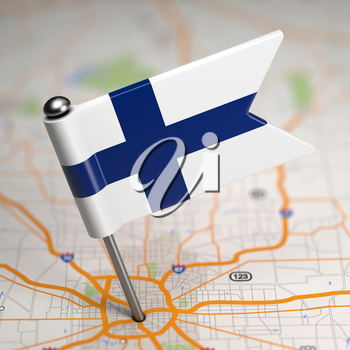 Small Flag of Republic of Finland on a Map Background with Selective Focus.