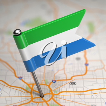 Small Flag of Sierra Leone on a Map Background with Selective Focus.