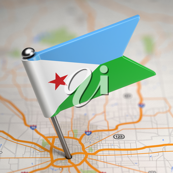 Small Flag Republic of Djibouti on a Map Background with Selective Focus.