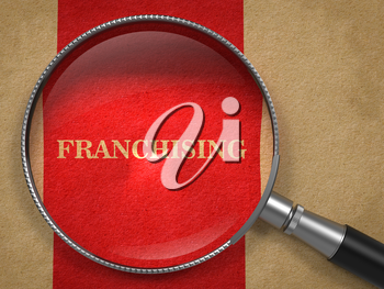 Franchising Concept. Magnifying Glass on Old Paper with Red Vertical Line Background.