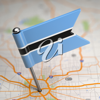Small Flag of Republic of Botswana on a Map Background with Selective Focus.