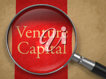 Venture Capital through Magnifying Glass on Old Paper with Red Vertical Line.