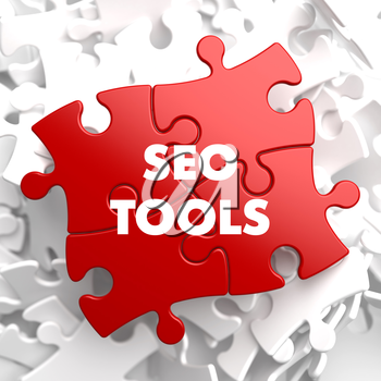 SEO Tools - Inscription on Red Puzzle on white background.