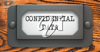 Confidential Data - Inscription on File Drawer Label on a Wooden Background.