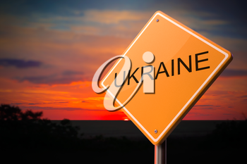 Ukraine on Warning Road Sign on Sunset Sky Background.
