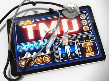 Medical Tablet with the Diagnosis of TMD on the Display and a Black Stethoscope on White Background.