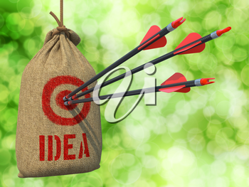 Idea - Three Arrows Hit in Red Target on a Hanging Sack on Natural Bokeh Background.