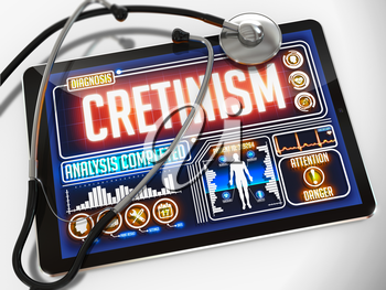 Cretinism - Diagnosis on the Display of Medical Tablet and a Black Stethoscope on White Background.