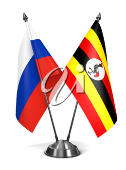 Russia and Uganda - Miniature Flags Isolated on White Background.