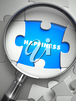 Happiness - Word on the Place of Missing Puzzle Piece through Magnifier. Selective Focus.