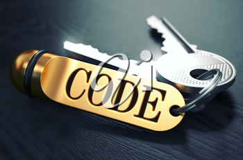 Keys and Golden Keyring with the Word Code over Black Wooden Table with Blur Effect. Toned Image.