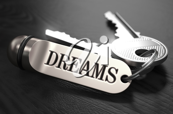 Keys to Dreams - Concept on Golden Keychain over Black Wooden Background. Closeup View, Selective Focus, 3D Render. Black and White Image.