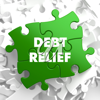 Debt Relief on Green Puzzle on White Background.