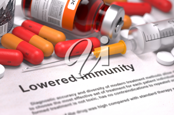 Lowered Immunity - Printed Diagnosis with Blurred Text. On Background of Medicaments Composition - Red Pills, Injections and Syringe.