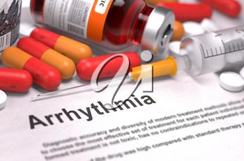 Arrhythmia - Printed Diagnosis with Red Pills, Injections and Syringe. Medical Concept with Selective Focus.