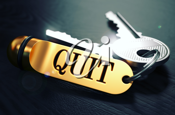 Keys and Golden Keyring with the Word Quit over Black Wooden Table with Blur Effect. Toned Image.