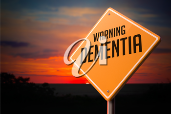 Dementia on Warning Road Sign on Sunset Sky Background.
