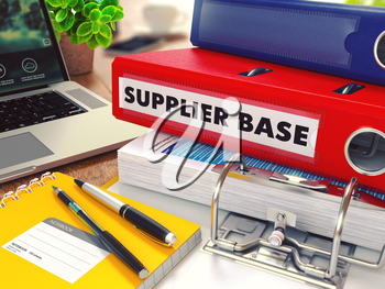 Supplier Base - Red Office Folder on Background of Working Table with Stationery, Laptop and Reports. Business Concept on Blurred Background. Toned Image.