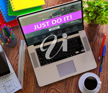 Just do It Concept. Modern Laptop and Different Office Supply on Wooden Desktop background.