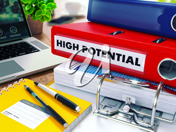 High Potential - Red Ring Binder on Office Desktop with Office Supplies and Modern Laptop. Business Concept on Blurred Background. Toned Illustration.