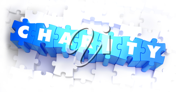 Charity -  Word on Blue Puzzles on White Background. 3D Render.