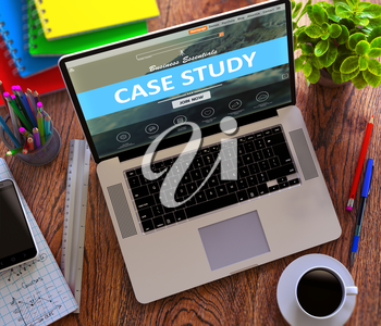 Case Study Concept. Modern Laptop and Different Office Supply on Wooden Desktop background.