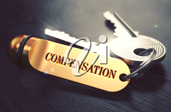 Keys with Word Compensation on Golden Label over Black Wooden Background. Closeup View, Selective Focus, 3D Render. Toned Image.