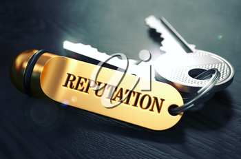 Keys and Golden Keyring with the Word Reputation over Black Wooden Table with Blur Effect. Toned Image.