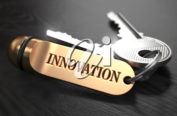 Keys to Innovation - Concept on Golden Keychain over Black Wooden Background. Closeup View, Selective Focus, 3D Render.