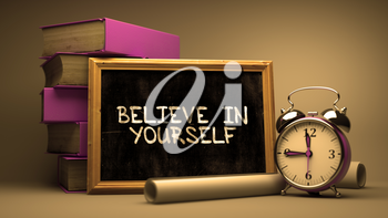 Believe in Yourself Handwritten on Chalkboard. Time Concept. Composition with Chalkboard and Stack of Books, Alarm Clock and Scrolls on Blurred Background. Toned Image.