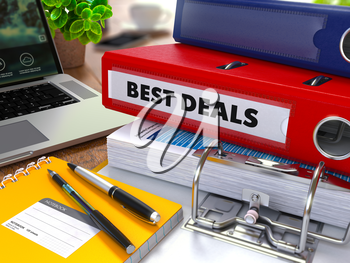 Red Ring Binder with Inscription Best Deals on Background of Working Table with Office Supplies, Laptop, Reports. Toned Illustration. Business Concept on Blurred Background.