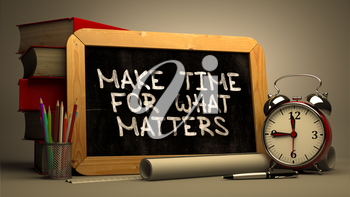 Make Time for What Matters - Chalkboard with Hand Drawn Text, Stack of Books, Alarm Clock and Rolls of Paper on Blurred Background. Toned Image.