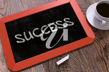 Success Handwritten on Red Chalkboard. Business Concept. Composition with Chalkboard and Cup of Coffee. Top View Image.