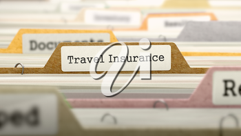 File Folder Labeled as Travel Insurance in Multicolor Archive. Closeup View. Blurred Image.