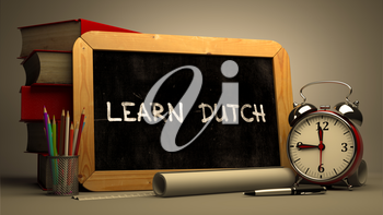 Learn Dutch Concept Hand Drawn on Chalkboard. Blurred Background. Toned Image.