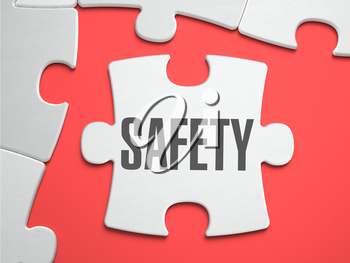 Safety - Text on Puzzle on the Place of Missing Pieces. Scarlett Background. Close-up. 3d Illustration.