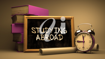 Hand Drawn Studying Abroad Concept on Chalkboard. Blurred Background. Toned Image.