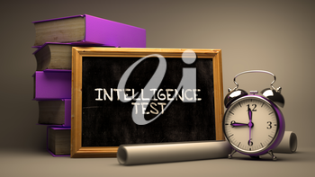 Intelligence Test Handwritten by white Chalk on a Blackboard. Composition with Small Chalkboard and Stack of Books, Alarm Clock and Rolls of Paper on Blurred Background. Toned Image.