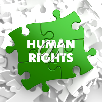 Human Rights on Green Puzzle on White Background.