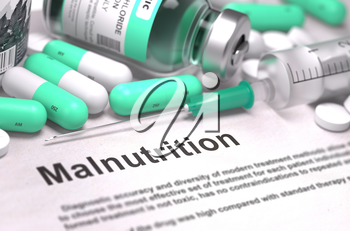 Malnutrition - Printed Diagnosis with Mint Green Pills, Injections and Syringe. Medical Concept with Selective Focus.