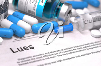 Lues - Printed Diagnosis with Blurred Text. On Background of Medicaments Composition - Blue Pills, Injections and Syringe.