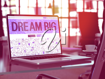 Modern Workplace with Laptop showing Landing Page in Doodle Design Style with Motivation Quote Dream Big. Toned Image with Selective Focus.