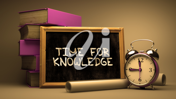 Handwritten Time for Knowledge on a Chalkboard. Composition with Chalkboard and Stack of Books, Alarm Clock and Rolls of Paper on Blurred Background. Toned Image.