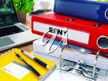 Rent - Red Ring Binder on Office Desktop with Office Supplies and Modern Laptop. Business Concept on Blurred Background. Toned 3d Illustration.