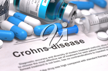 Crohns Disease - Printed Diagnosis with Blurred Text. On Background of Medicaments Composition - Blue Pills, Injections and Syringe. 3d Render.