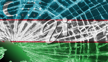 Isolated broken glass or ice with a flag, Uzbekistan