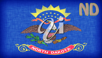 Linen flag of the US state of North Dakota with it's abbreviation stitched on it