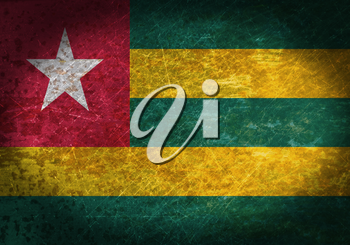 Old rusty metal sign with a flag - Togo