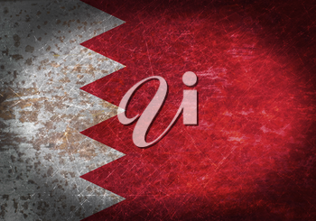 Old rusty metal sign with a flag - Bahrain