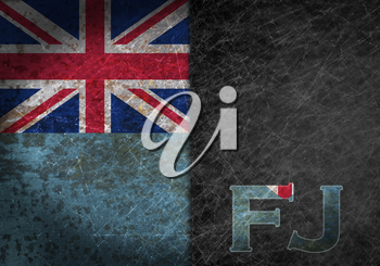 Old rusty metal sign with a flag and country abbreviation - Fiji